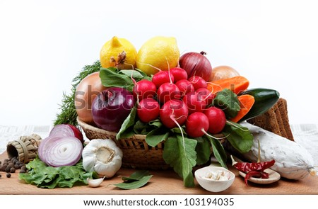 Healthy food. Fresh vegetables and fruits on a wooden board. #103194035