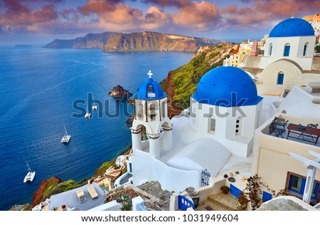 Fira town on Santorini island, Greece. Incredibly romantic sunrise on Santorini. Oia village in the morning light. Amazing sunset view with white houses. Island of lovers #1031949604