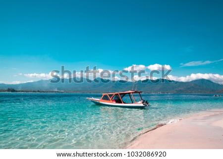 Beautiful view of boat on the sea tropical beach, Gili Trawangan, Lombok, Indonesia #1032086920