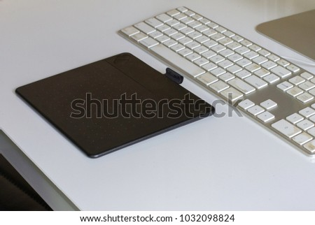 Graphic designer tablet on home office desk about to start work for the day #1032098824