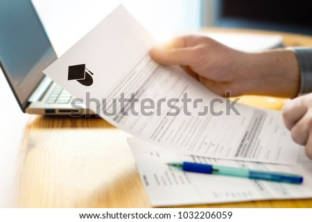 Man reading college or university application or document from school. College acceptance letter or student loan paper. Applicant filling form or planning studies. #1032206059