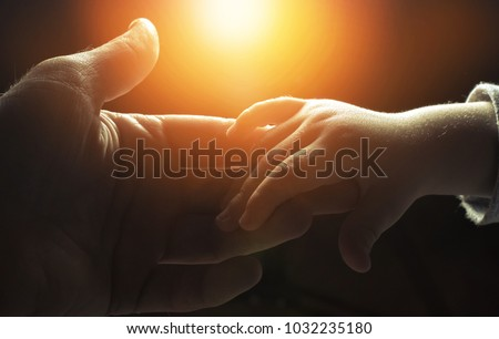 hand of man and child,God's help Royalty-Free Stock Photo #1032235180