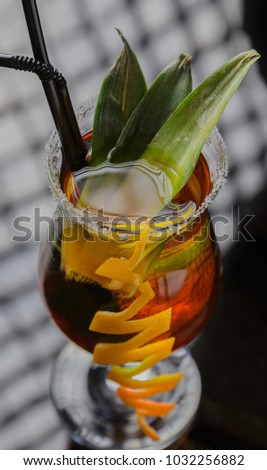 Glass with a cocktail on a glass table #1032256882