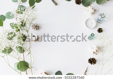 Flat lay top view photo. Mockup on a grey background  with gentle flowers and plants. Cute feminine mockup. Blog header image. Blank space.