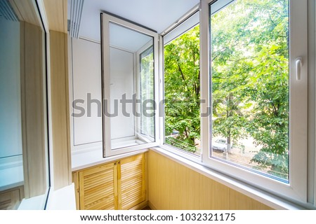 Open window with a view of the forest Royalty-Free Stock Photo #1032321175
