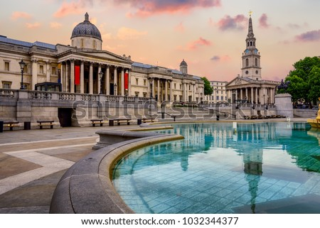 The Trafalgar square in London, England, with National Gallery and St Marting on the Fields church in dramatic light Royalty-Free Stock Photo #1032344377