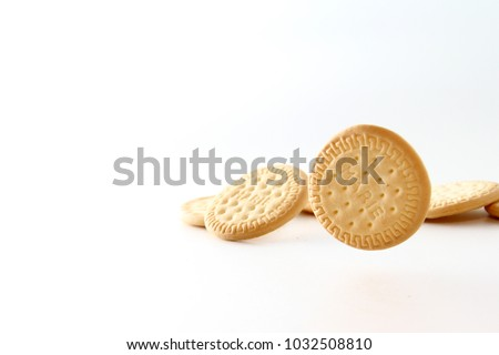 Marie biscuit in white background / A Marie biscuit is a type of biscuit similar to a rich tea biscuit. #1032508810
