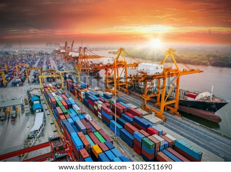 Logistics and transportation of Container Cargo ship and Cargo plane with working crane bridge in shipyard at sunrise, logistic import export and transport industry background #1032511690