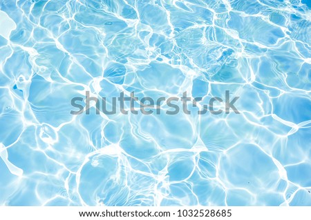 surface of blue swimming pool,background of water in swimming pool. Royalty-Free Stock Photo #1032528685