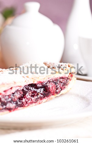 Cherry strudel with white dishes closeup #103261061