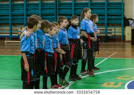 ODESSA, UKRAINE- Febr 24,2018: Young children play rugby during derby games of city school in closed hall. Children's sports. Children play in rugby 5. Fight for victory of children. Healthy lifestyle #1032656758