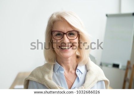 Smiling attractive senior businesswoman wearing glasses head shot, happy aged teacher, successful woman company boss, older female executive, mature lady professional looking at camera, portrait #1032686026