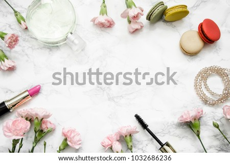 women's accessories with cloves on a marble background #1032686236