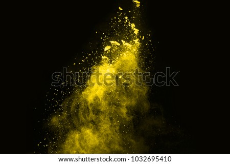 Abstract yellow powder splatted background,Freeze motion of color powder exploding/throwing color powder,color glitter texture on black background. #1032695410