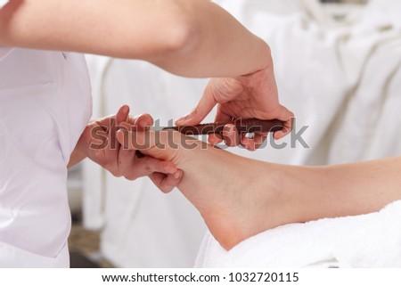 close up of thai foot massage #1032720115