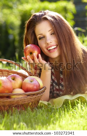 Beautifuwoman  in the garden with apples #103272341