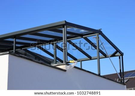 Modern high-quality balcony canopy, terrace canopy Royalty-Free Stock Photo #1032748891