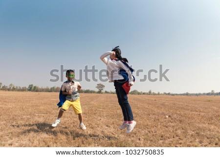 Superhero Kid Playing Fun Cheerful Concept. #1032750835
