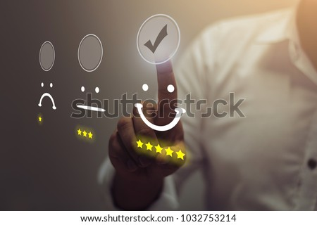 Businessman pressing smiley face emoticon on virtual touch screen. Customer service evaluation concept. Royalty-Free Stock Photo #1032753214