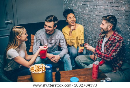 Another picture of teenagers talking with each other and laughing at the same time. They decided to get together to play some games and just have fun. Party night.