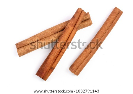 Cinnamon sticks isolated on white background. Top view Royalty-Free Stock Photo #1032791143