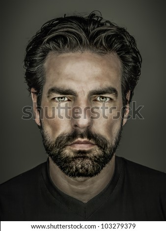 An image of a handsome man with a beard #103279379