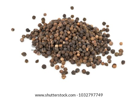 Heap of raw, natural, unprocessed black pepper peppercorns over white background #1032797749
