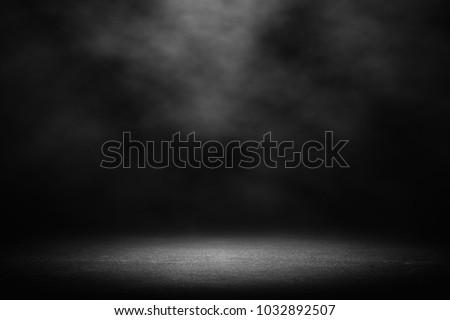cement floor in dark room with spot light. black background. #1032892507