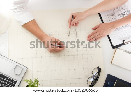 Architects working on blueprint, real estate project. Architect workplace - architectural project, blueprints, ruler, calculator, laptop and divider compass. Construction concept. Engineering tools. #1032906565