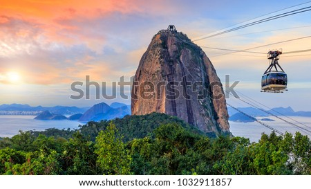 Cable car and  Sugar Loaf mountain in Rio de Janeiro #1032911857