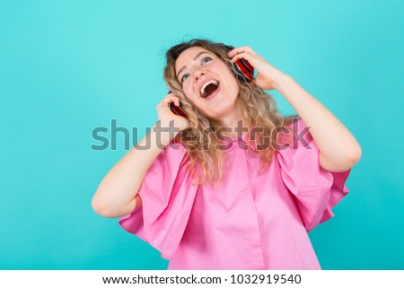 Woman DJ in shirt with headphones #1032919540