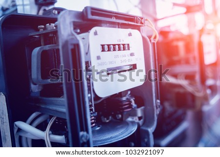 Electrical equipment. Electricity cable and crimper. Electricity meter. Background #1032921097