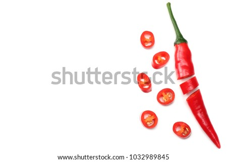 sliced red hot chili peppers isolated on white background top view #1032989845