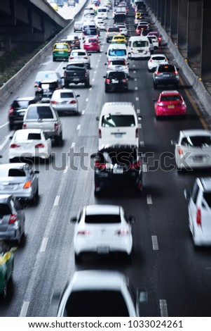 Controlled-access highway in Bangkok during rush hour. blurry  #1033024261