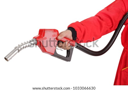 Hand is holding red gasoline pistol pump fuel nozzle #1033066630