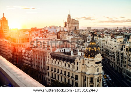 Cityscape of Madrid at sunset, with Gran Vía street. #1033182448