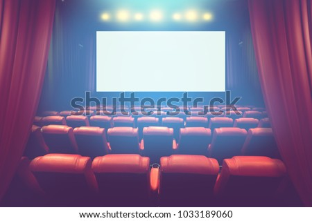 empty theater auditorium with blank screen or movie cinema with red seats before show time #1033189060