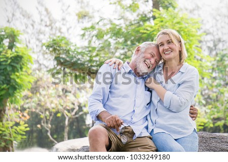 Happy old elderly caucasian couple smiling in park on sunny day, hoot senior couple relax in spring summer time. Healthcare lifestyle elderly retirement love couple together valentines day concept  #1033249180