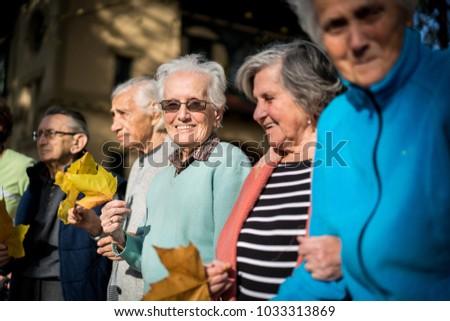 Elderly people in park together #1033313869
