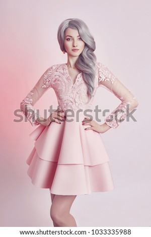 Beautiful anime doll girl in pink dress on pink background. A girl with long blonde ash hair. Fabulous look of woman anime heroine