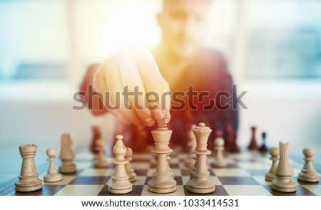 Businessman play with chess game. concept of business strategy and tactic #1033414531