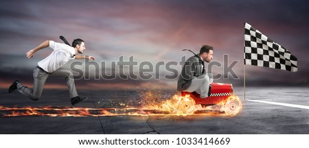 Fast businessman with a car wins against the competitors. Concept of success and competition Royalty-Free Stock Photo #1033414669