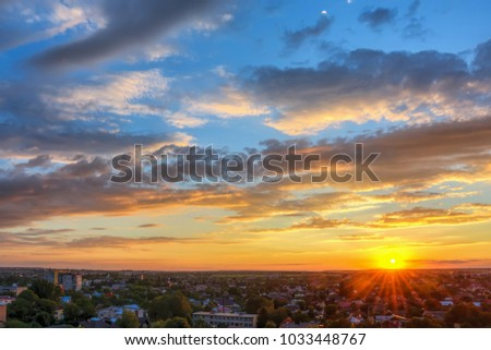 Sky with clouds over the evening city at sunset. #1033448767