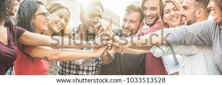 Young happy people stacking hands outdoor - Diverse culture students celebrating together - Youth lifestyle, university, relationship, human resorces, work and friendship concept - Focus on hands #1033513528