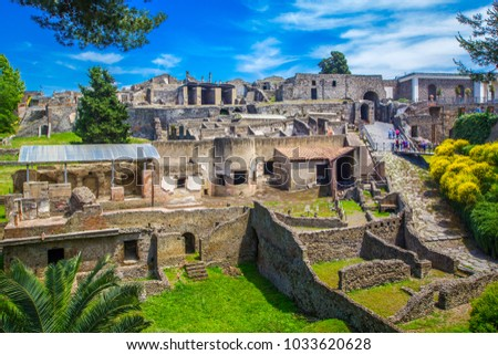 Panoramic view of the ancient city of Pompeii with houses and streets. Pompeii is an ancient Roman city died from the eruption of Mount Vesuvius in the 1st century. Naples, Italy. #1033620628
