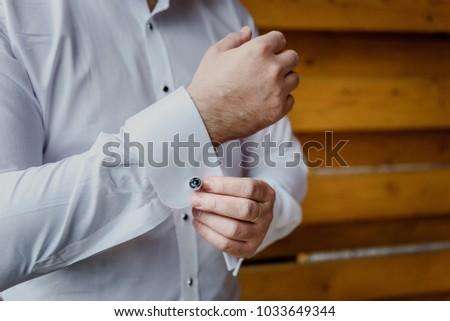 A man dresses cufflinks #1033649344