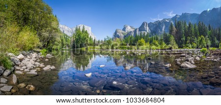 Panoramic view of famous Yosemite Valley with beautiful Merced river on a scenic sunny day with blue sky in summer, Yosemite National Park, California, USA #1033684804