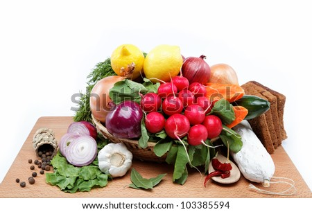 Healthy food. Fresh vegetables and fruits on a wooden board. #103385594
