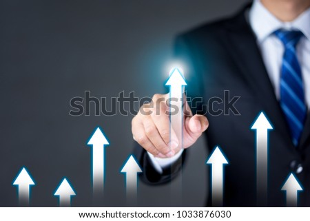 Businessman touching the arrow pointing up. Development, competition, growth of business concept. #1033876030