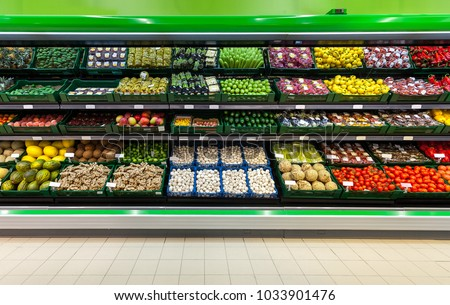 Fresh fruits and vegetables on the shelf in the supermarket   Royalty-Free Stock Photo #1033901476